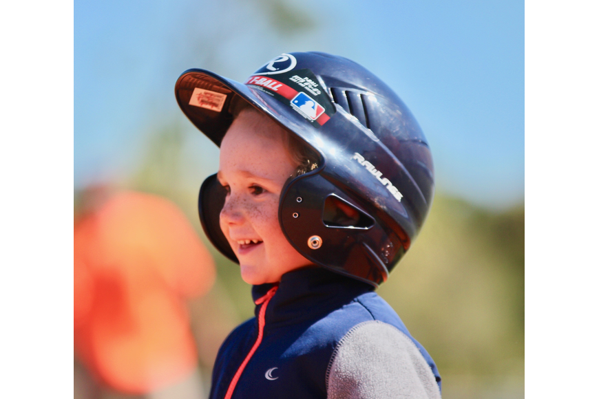 Oliver Prier, 4, smiles after reaching home plate. Photo by Ray Boone