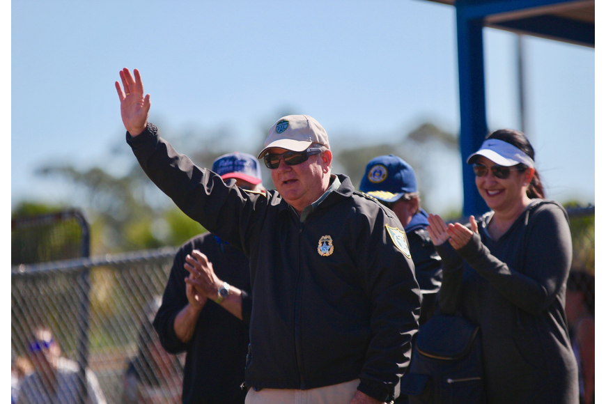 Flagler County Sheriff Rick Staly waves to the crowd at the Palm Coast Little League's opening day ceremony. Photo by Ray Boone