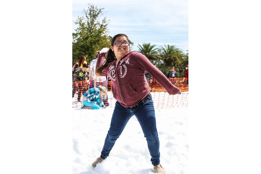 Palm Coast resident Adriana Bass winds up to throw a snowball. Photo by Paige Wilson