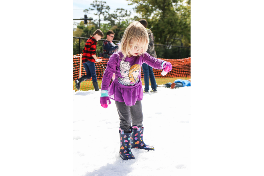 Palm Coast resident Avery Wiltfong holds a snowball. Photo by Paige Wilson