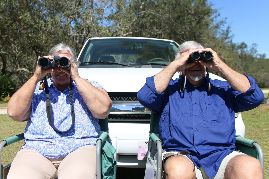 Judie and Joe Dziak look through their binoculars at the eagle nest in Princess Place Preserve. Photo by Paige Wilson