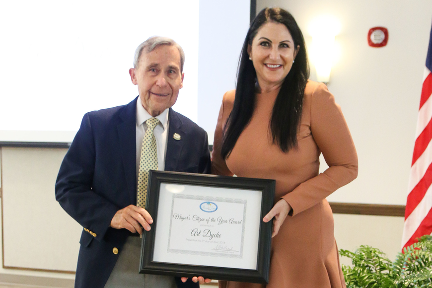 Palm Coast Mayor Milissa Holland presents City Historian Art Dycke with the Mayor's Citizen of the Year Award. Photo by Paige Wilson