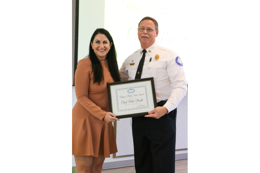 Palm Coast Mayor Milissa Holland presents Palm Coast Fire Chief Mike Beadle with the first Mayor's Public Service Award. Photo by Paige Wilson