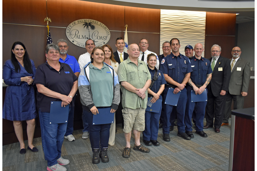 Palm Coast resident Serge Judro, center, attended the Palm Coast City Council meeting April 3 to help honor the Palm Coast Fire Engine 21 crew and Judro's coworkers for their roles in saving his life. Photo courtesy of Cindi Lane