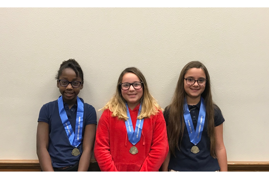 Tropicana Speech winners fourth-grader London Streeter, sixth-grader Anjeli Izquierdo and fifth-grader Ashtyn Alonzo from First Baptist Christian Academy. Photo courtesy of Stephanie Sumler