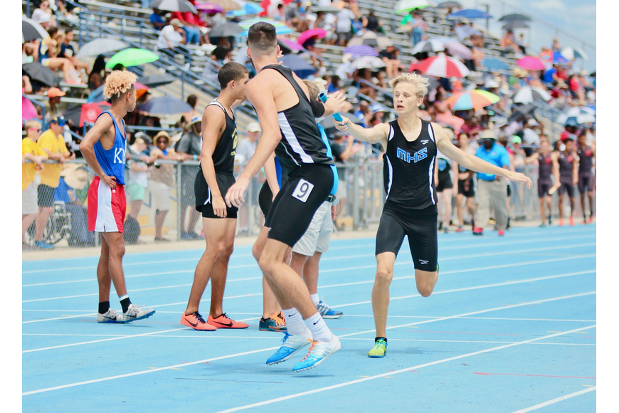 Matanzas' Jacob Miley receives the baton from teammate Dalton Hawley. Photo by Ray Boone