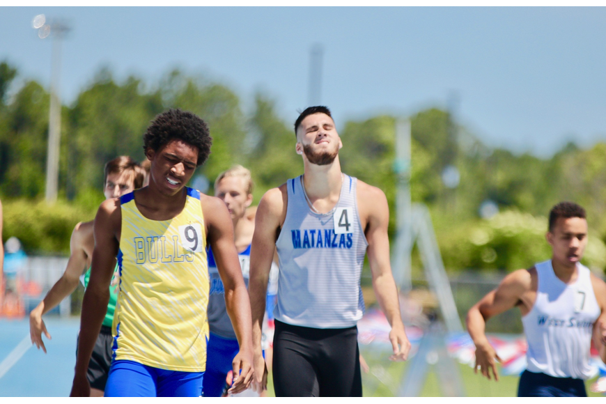Matanzas' Jacob Miley grimaces after finishing in eighth place in the boys 3A 800-meter run. Photo by Ray Boone