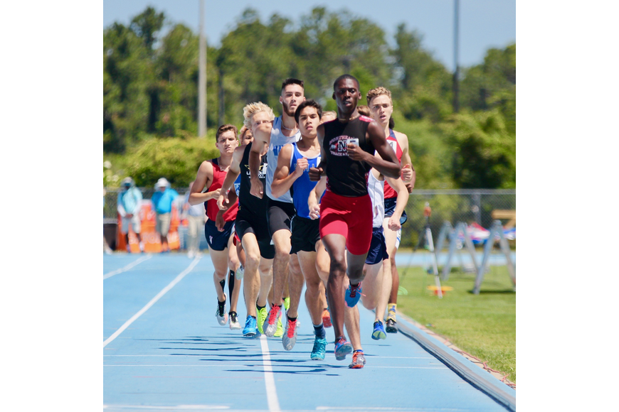 Matanzas' Jacob Miley in the middle of the pack during the first leg of the boys 800-meter run. Photo by Ray Boone