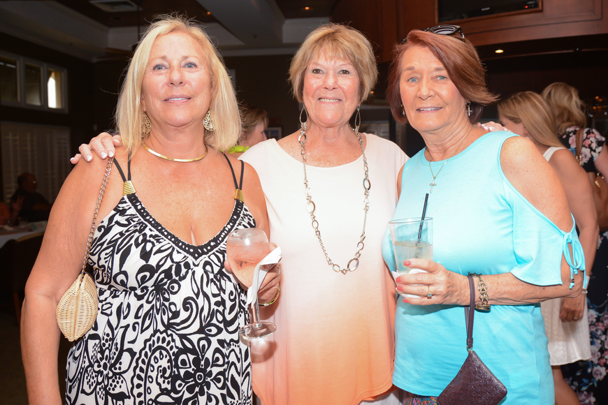 Linda Robinson, of Flagler Beach, Liz Colombo, of Palm Coast, and Shirley Dyson, of Orange Park, attend the FHS fundraiser. Photo by Paige Wilson