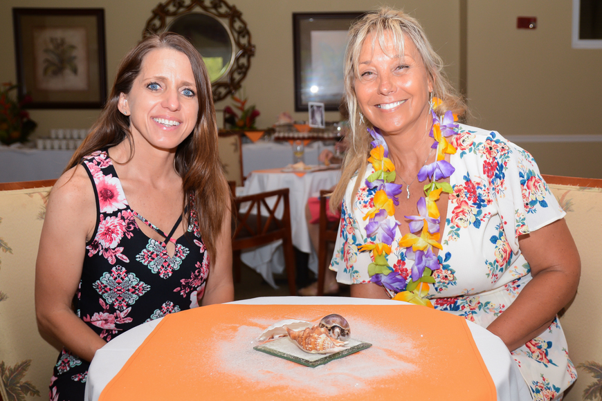 Flagler County Sheriff's Office Detective Annie Conrad and FHS Executive Director Amy Wade-Carotenuto pose together before Conrad is recognized with a plaque as the night's honoree. Photo by Paige Wilson