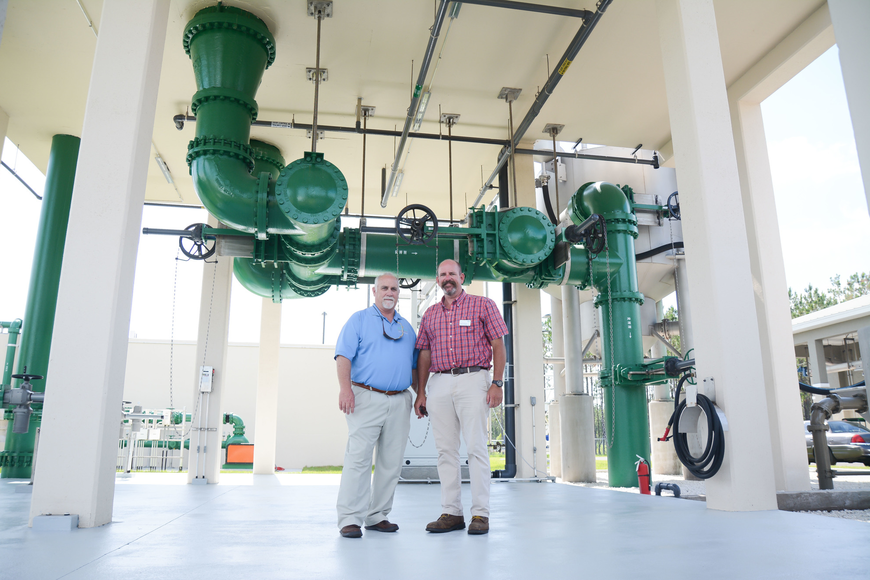 Utility System Manager Danny Ashburn and Chief Operator for the city of Palm Coast Patrick Henderson pose for a photo in the head works area. Photo by Paige Wilson