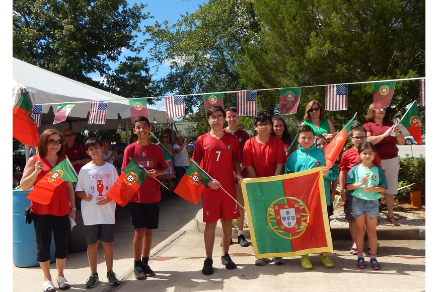 Children who attend the Portuguese Language School pose at the flag raising event. Photo courtesy of Maria Elizabeth Frazao Pereira