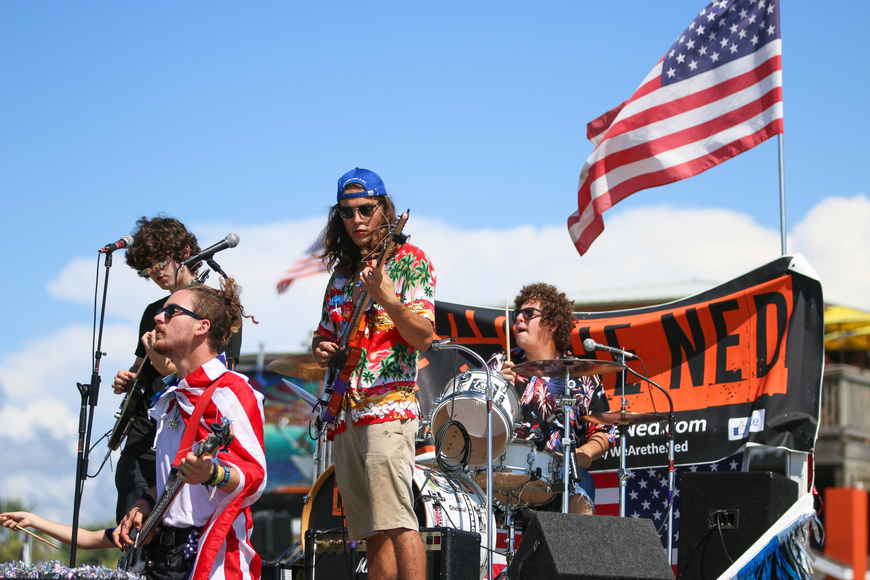 Palm Coast band The Ned hype up the crowd on a moving, musical float. Photo by Paige Wilson