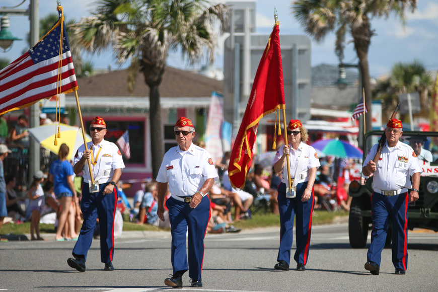Flagler County Marine Corps League Detachment 876 members walk in the parade. Photo by Paige Wilson