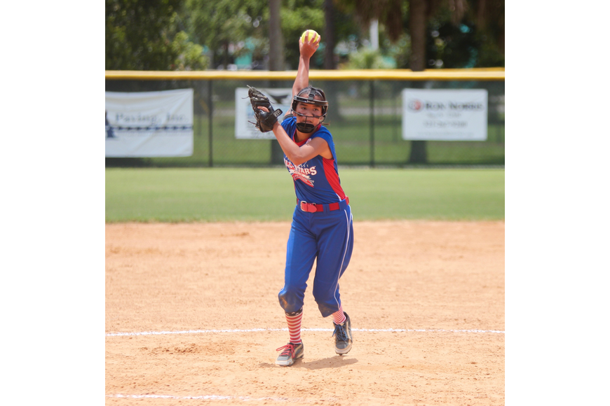 Palm Coast's Chloe Baker throws a pitch against Mims. Photo by Ray Boone