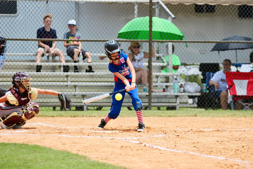 Chloe Rudy swings at a pitch against Mims. Photo by Ray Boone