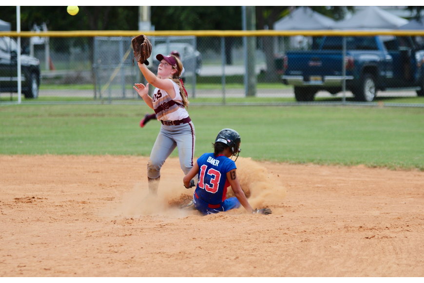 Chloe Baker slides into second base against Mims. Photo by Ray Boone