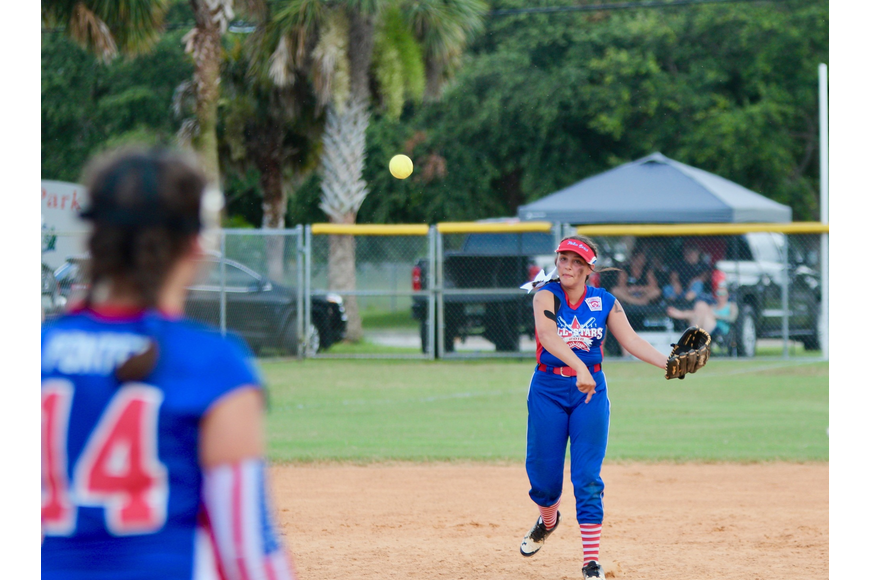 A Palm Coast player throws a ball toward first base. Photo by Ray Boone