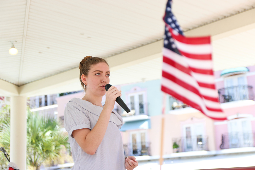 Matanzas High School graduate Melanie Alfin sings the National Anthem at the cook-off. Photo by Paige Wilson