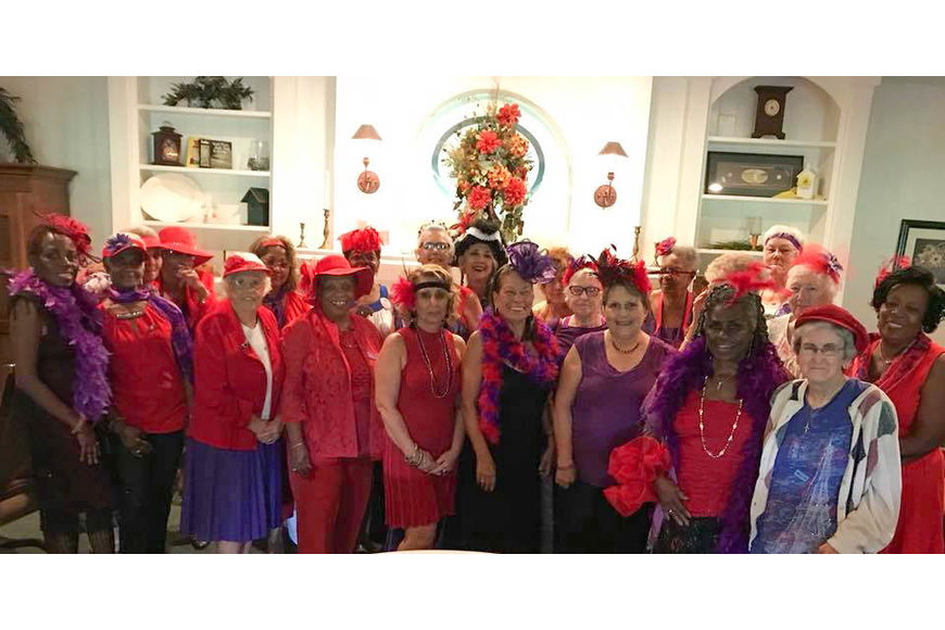The Palm Coast chapter of the Red Hat Society, the Purple Passions, celebrated 15 years as an organization, at Halifax Golf Club on Saturday, Sept. 15. Photo courtesy of Jean Sanderson