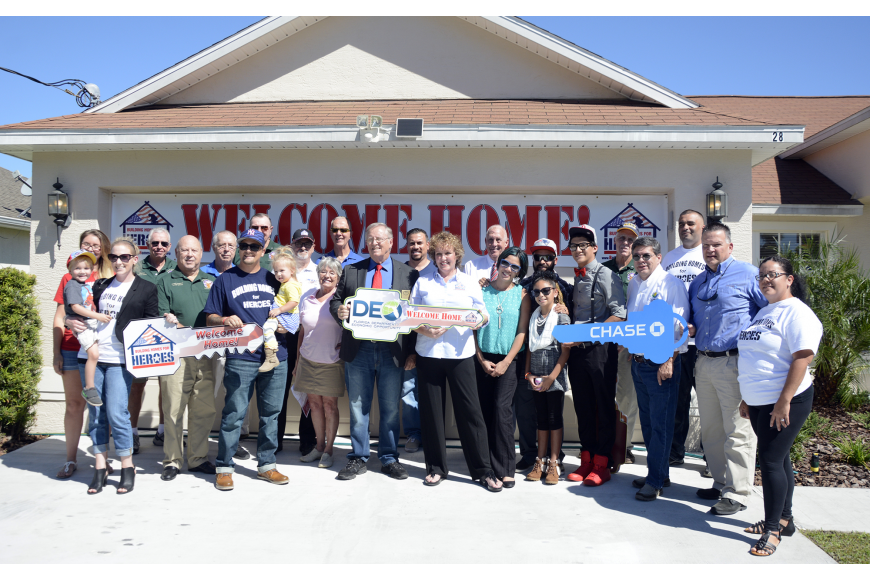 The De Leon, Danker, Sosa and Rosairo families who have all received a home through Building Homes for Heroes, with Vice Mayor Bill McGuire, County Commisioners Nate McGloklin, Charlie Ericksen and members of the Elks Lodge