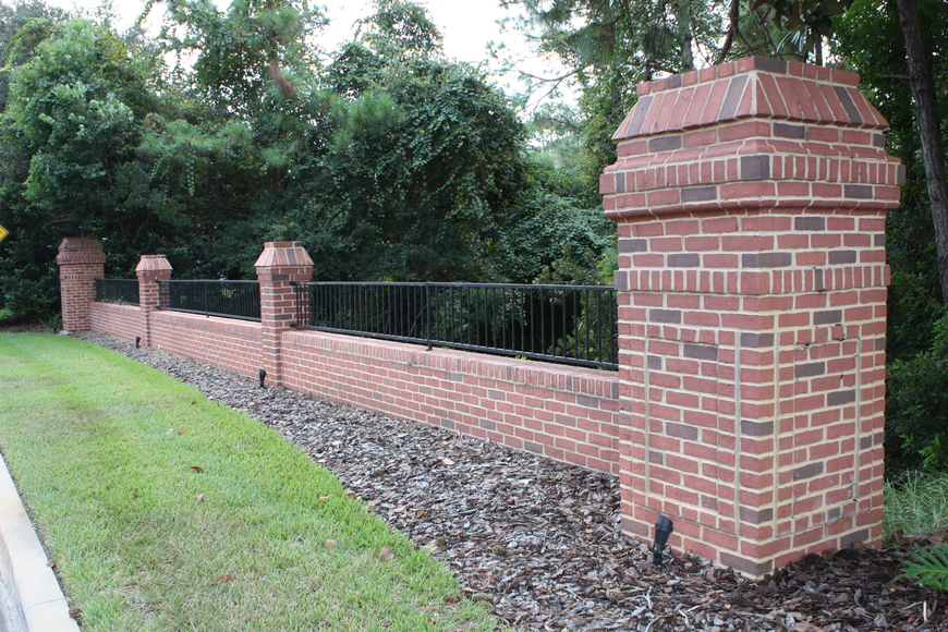 This wall on a bridge leading into the Bay Isles II subdivision was painted white, but residents were able to get it restored to the brick look. Photo by Wayne Grant