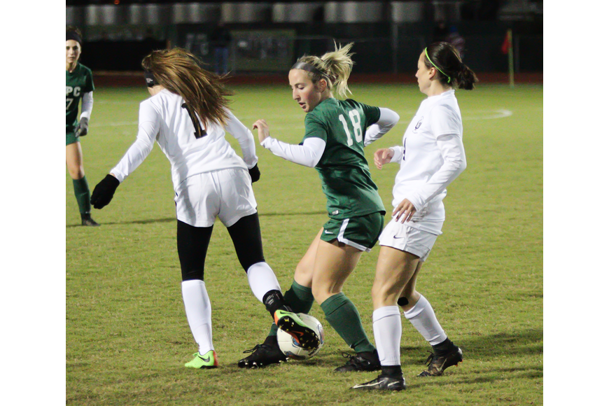 Alexis Buglione fights for the ball against Spruce Creek. Photo by Ray Boone