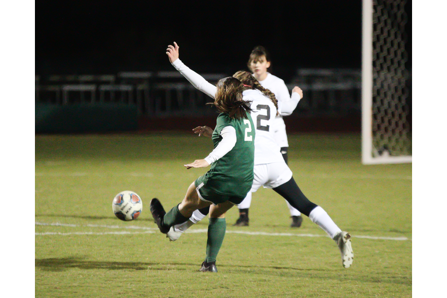 Ashley Buglione takes a shot toward the goal. Photo by Ray Boone