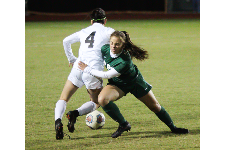 Brielle Landry fights for the ball with a Spruce Creek player. Photo by Ray Boone