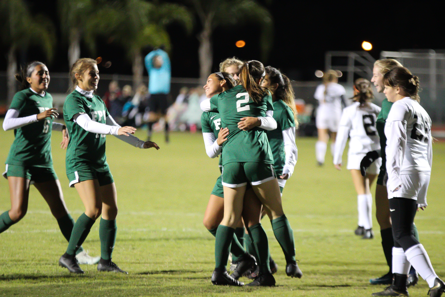 The Bulldogs celebrate after Emily Puentes scored a goal. Photo by Ray Boone