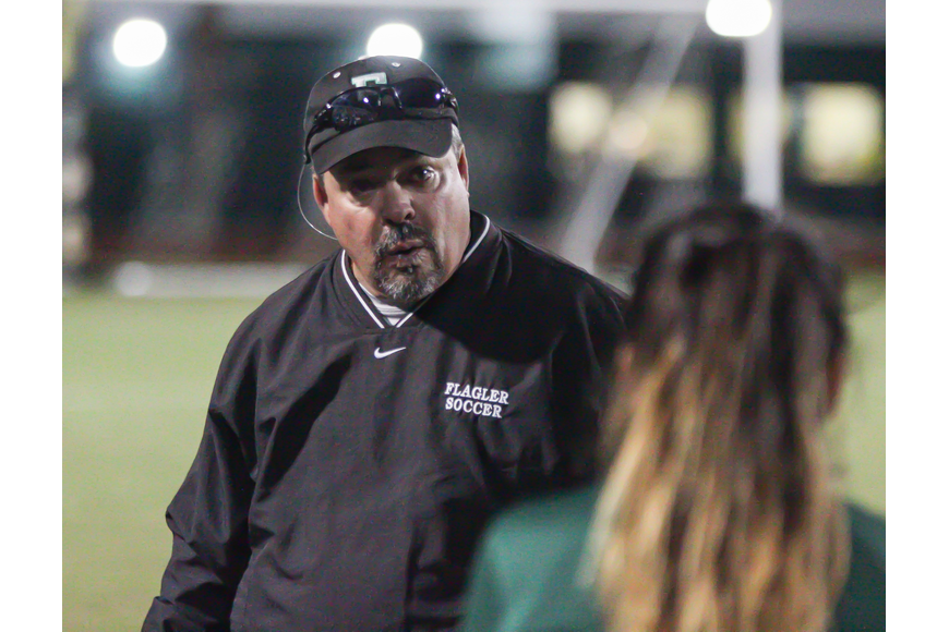 Head coach Pete Hald talks to a player on the sideline. Photo by Ray Boone