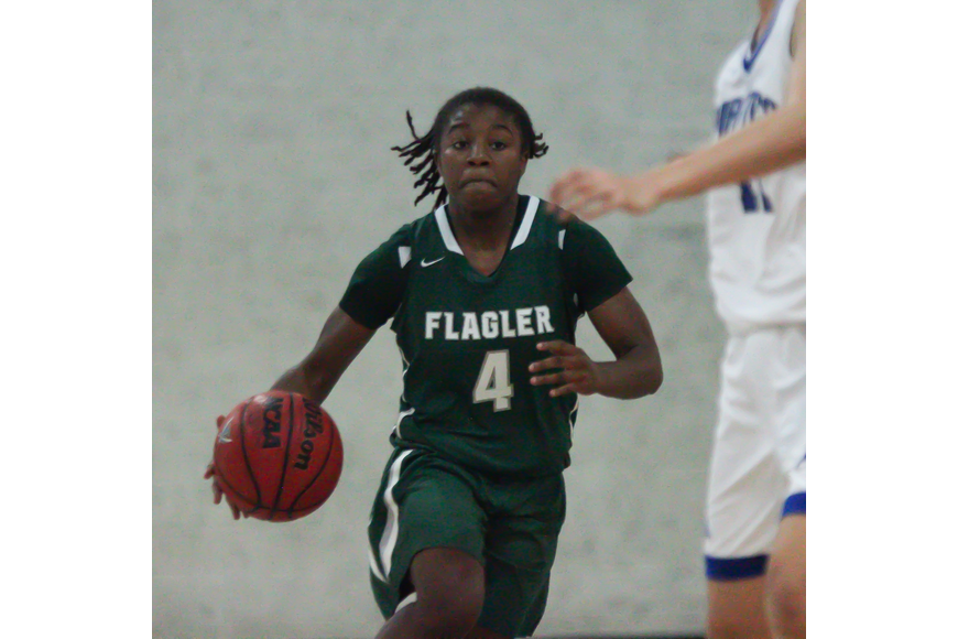 FPC's Jimaya Baker dribbles the ball up the court. Photo by Ray Boone