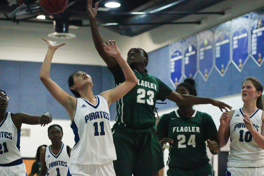 FPC's Prosperity Wright blocks a shot against Matanzas. Photo by Ray Boone