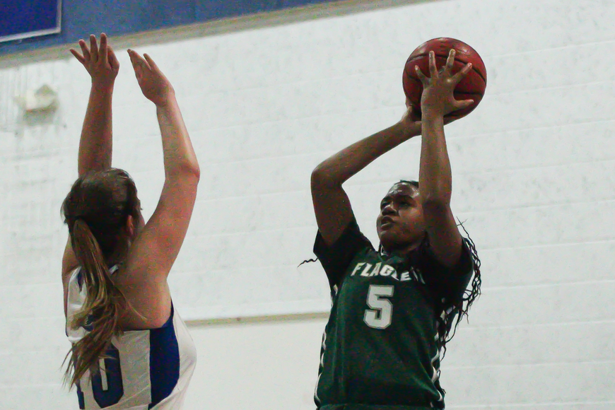 FPC's Leah Simpson shoots the ball over a Pirate. Photo by Ray Boone