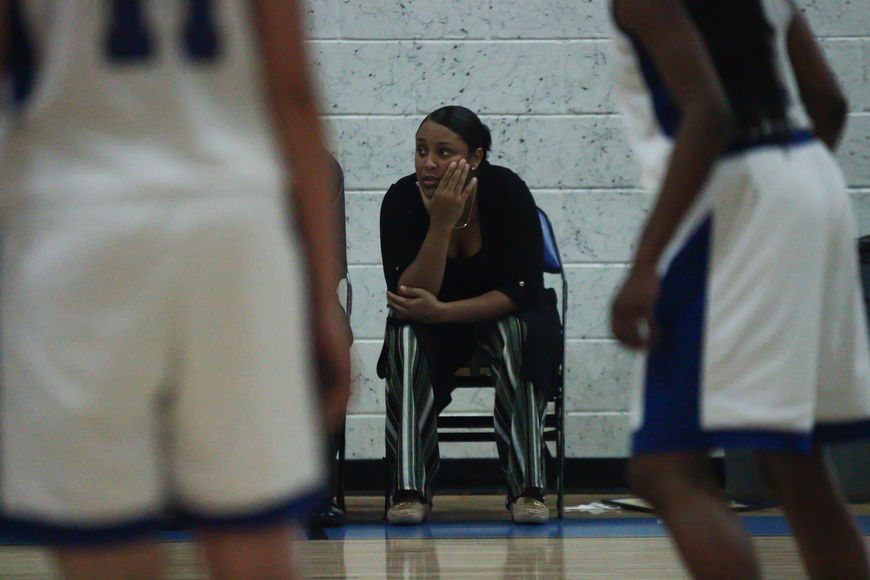 Pirates coach Monterika Warren watches her team from the bench. Photo by Ray Boone