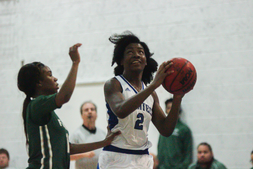 Arnesia Powell attempts a layup against FPC. Photo by Ray Boone
