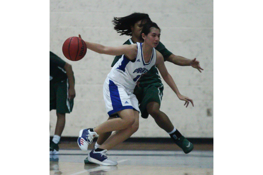 A Matanzas player dribbles the ball against FPC's defense. Photo by Ray Boone