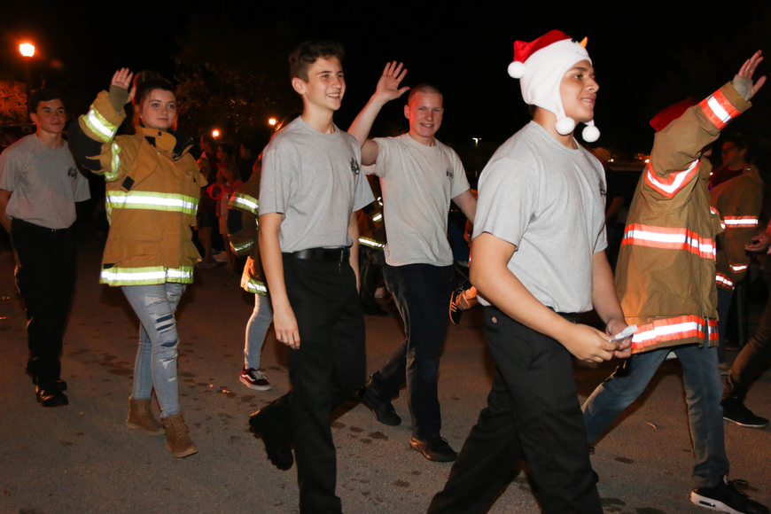 Members of the Flagler Palm Coast High School Fire Academy wave in the parade. Photo by Paige Wilson