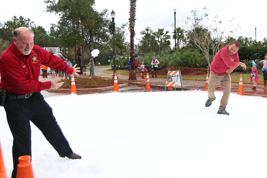 Flagler County Commissioner Joe Mullins throws a snowball at Flagler County Sheriff Rick Staly. Photo by Paige Wilson