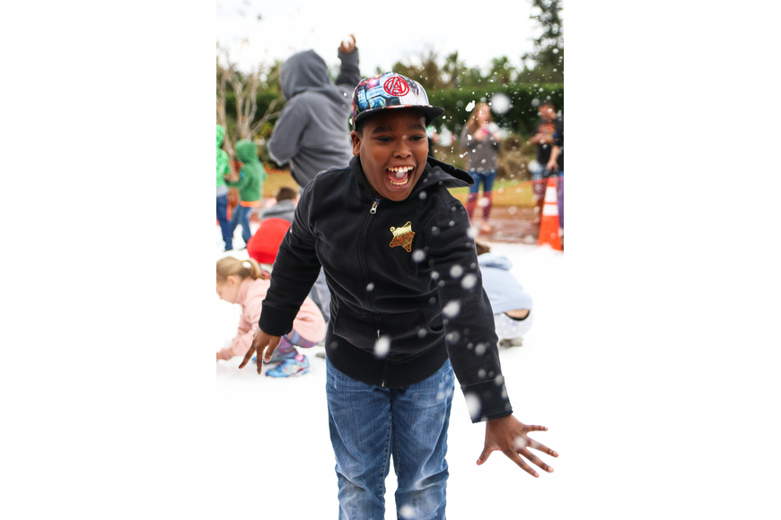Palm Coast resident Isaiah Wiggins enjoys the snowfield. Photo by Paige Wilson