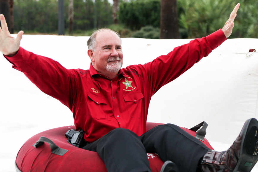 Flagler County Sheriff Rick Staly shows his enthusiasm on the slide. Photo by Paige Wilson
