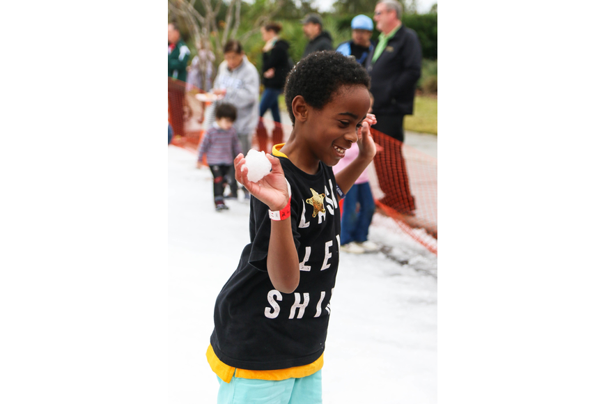 Palm Coast resident Amare Hense aims a snowball. Photo by Paige Wilson