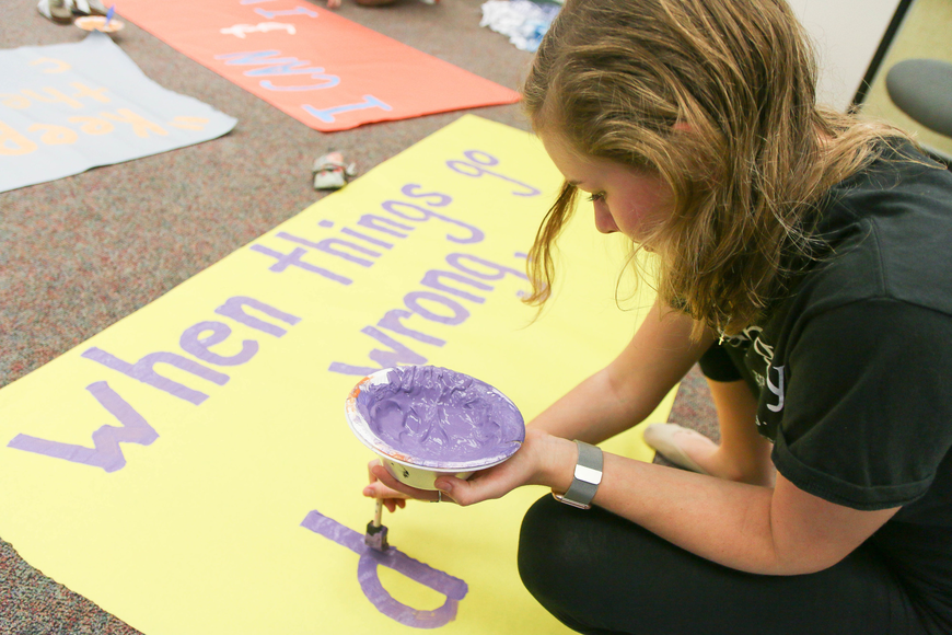 FPC SGA member Amy Raleigh paints a banner that will read: