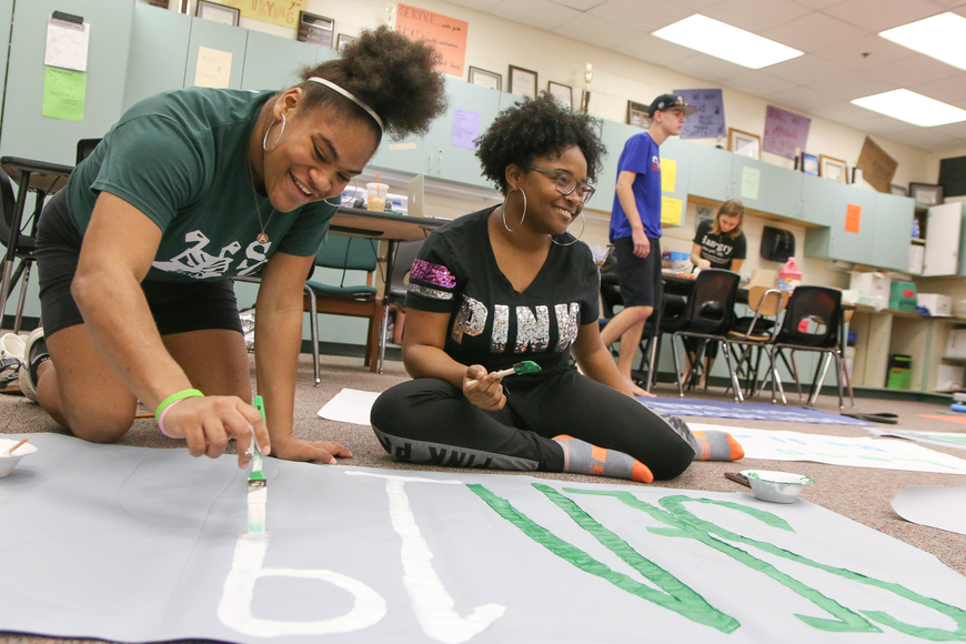 FPC SGA members Anniel Buchanan and Shavonne Brown paint a message to encourage seniors to finish their last four months strong. Photo by Paige Wilson