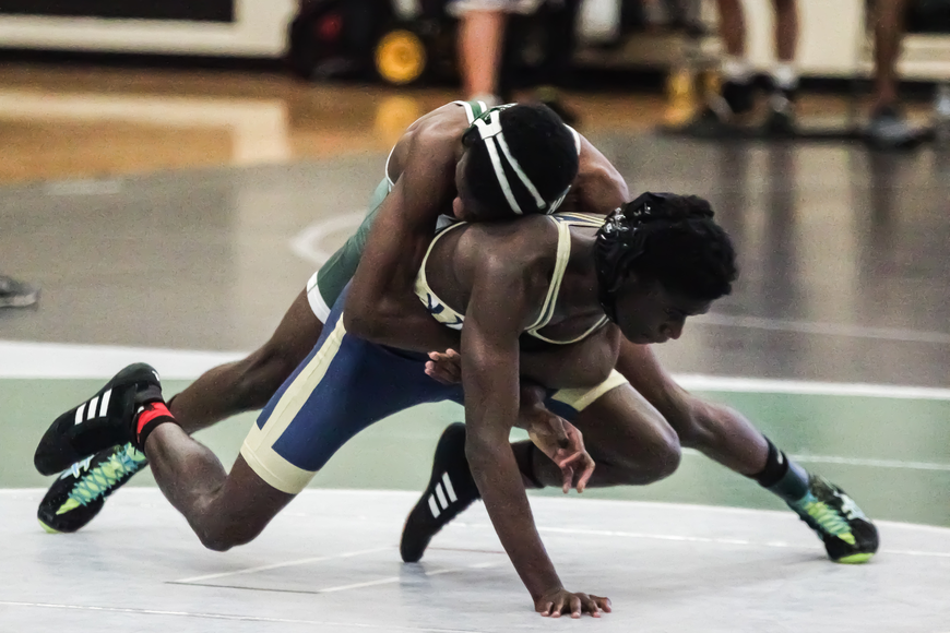 FPC's Tim King attempts to pin an opposing grappler at the Flagler Rotary wrestling tournament. Photo by Ray Boone