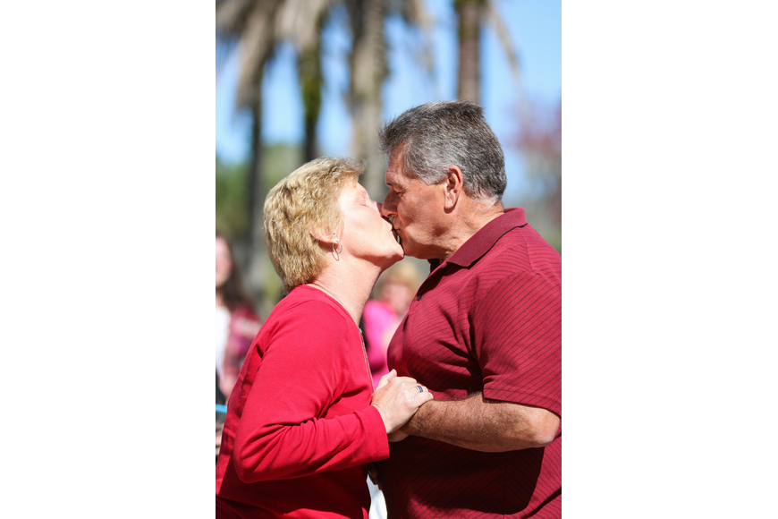 Deborah and Richard Cardoza renew their vows with a kiss. Photo by Paige Wilson