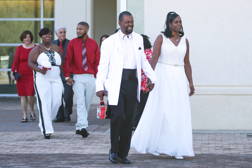 Nancy Nance and Rick Cannizzaro, Sybria Williamson and Twhan Johnson, and Sidney Bayne and Karen Weathers walk outside the courthouse to get married. Photo by Paige Wilson