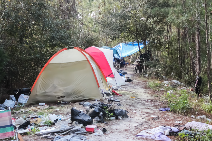The homeless camp behind the Flagler County Public Library is covered in trash and human waste, creating a hazard to the public. Photo by Ray  Boone