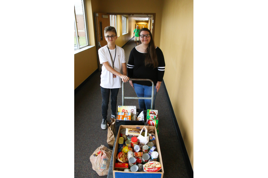 ITMS student Cameron Driggers and FPC student Isabella Colindres stands by the food Community Problem Solver group Waste Not Want Not collected: totaling about $250 worth of goods. Photo by Paige Wilson