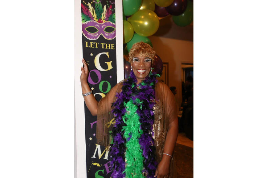 Jearlyn Dennie dresses for the Mardi Gras theme. Photo by Paige Wilson